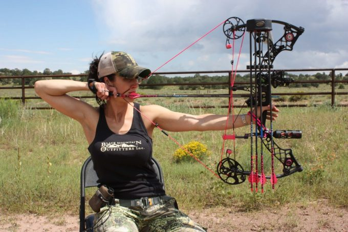 woman with compound bow
