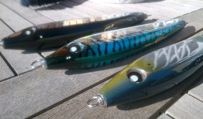 fishing lures on wooden boards