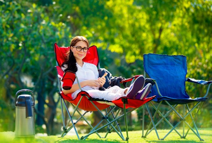 woman sitting in camping chair
