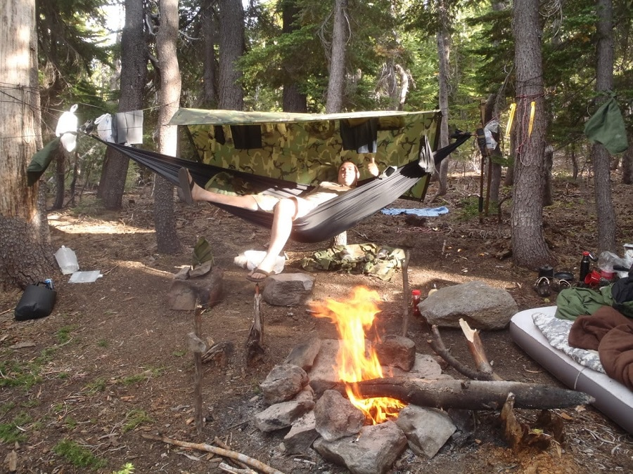 Drying clothes around campfire