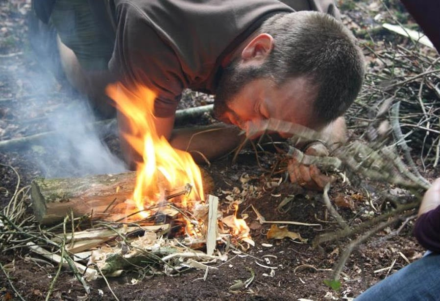 Lighting a fire in forest