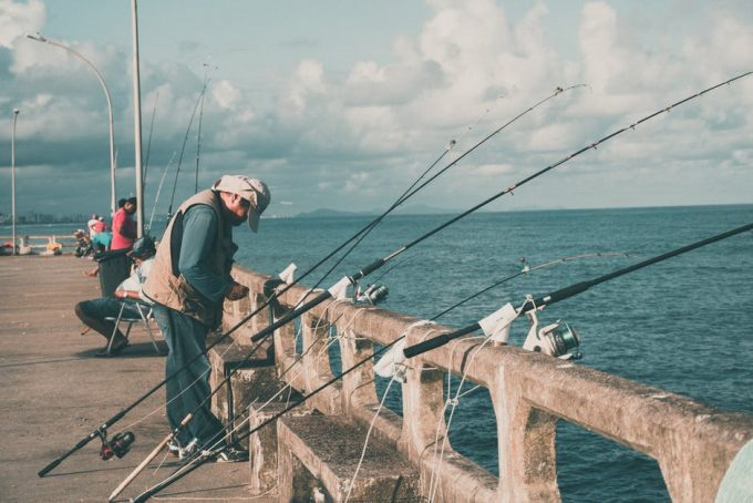 Fisherman with fishing rods