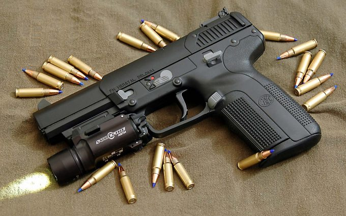 Tactical flashlight on a gun