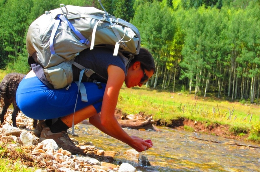 Backpacking gear in wilderness