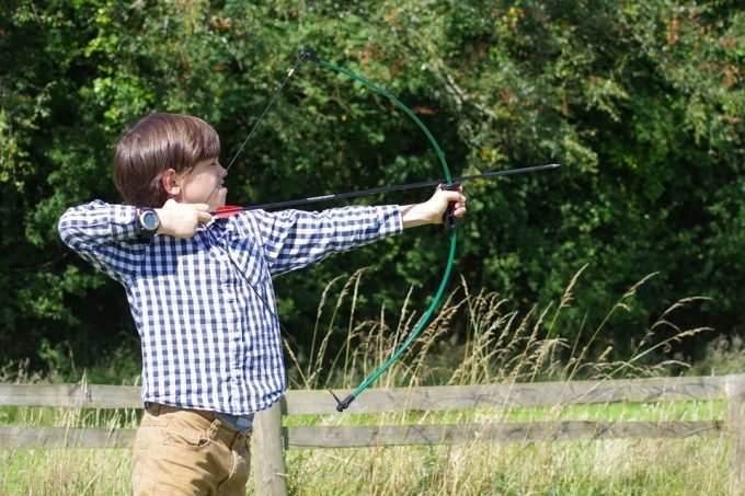 Kid shooting arrow
