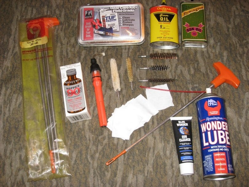 Tools for cleaning a rifle