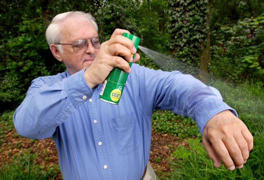Man with repellent spray
