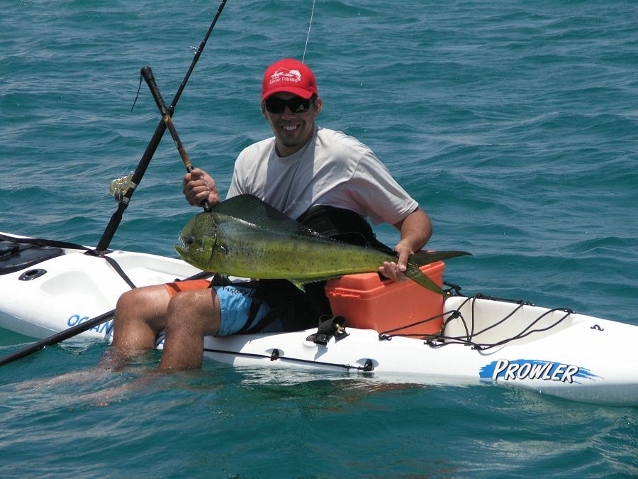 Fish on a fishing kayak with a man