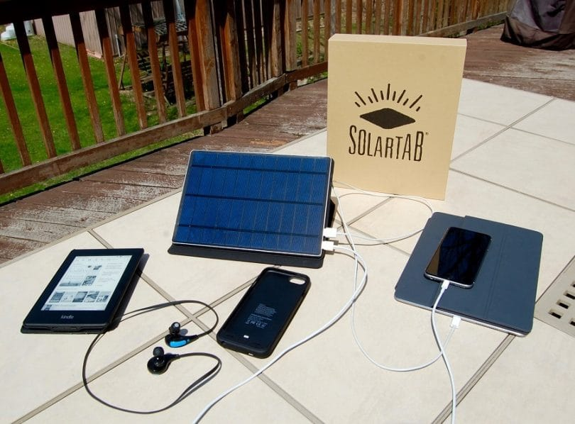 SolarTab chargers charging phones