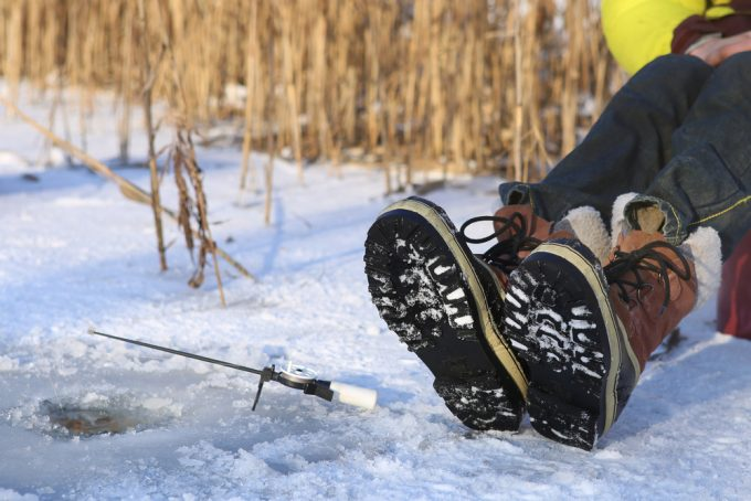 Fisherman wearing ice fishing boots