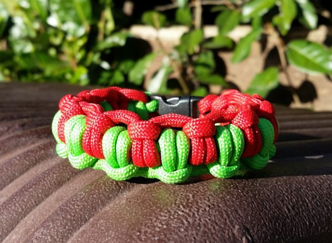 red and green paracord bracelet.png