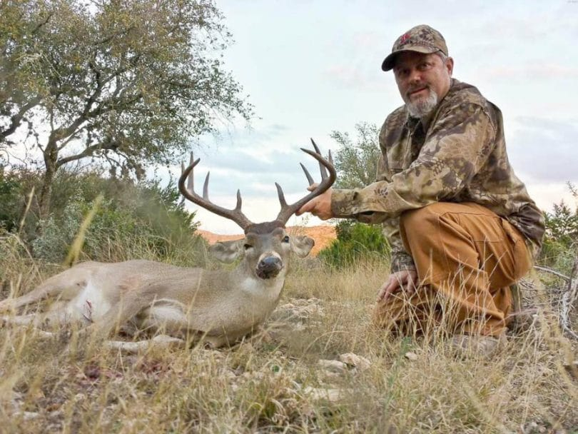Man with Whitetail Deer
