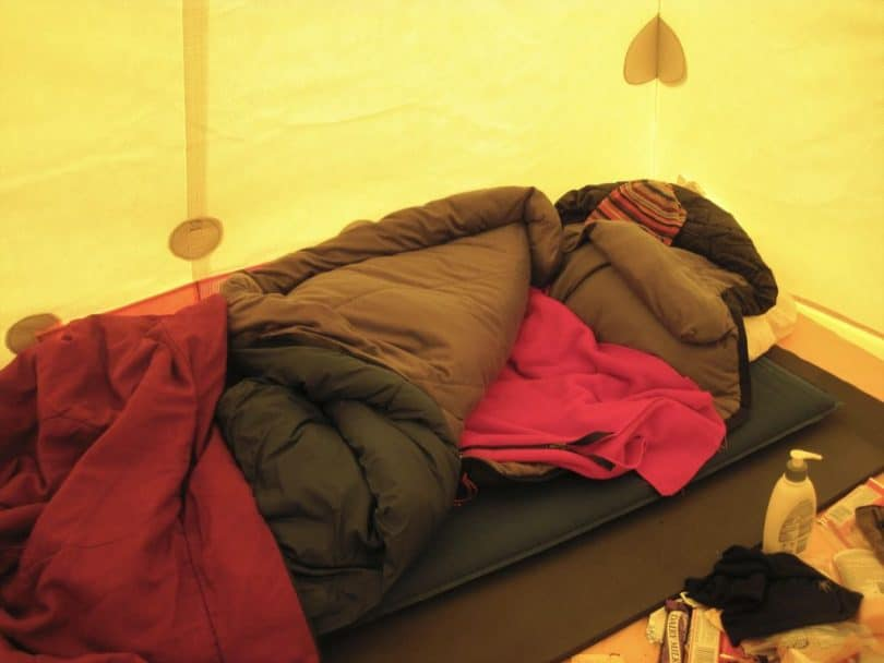 sleeping setup in a yellow tent