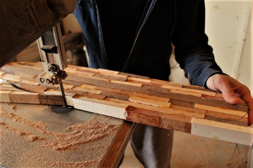 man cutting paddle with machine