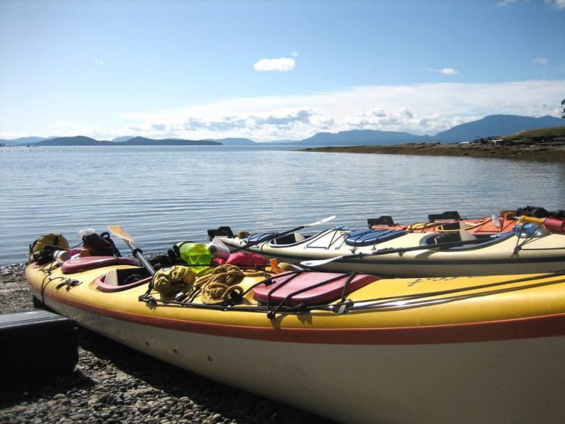 kayak filled with stuff on a beach