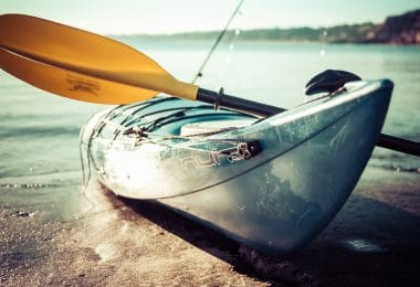 Kayak with a yellow paddle - close up