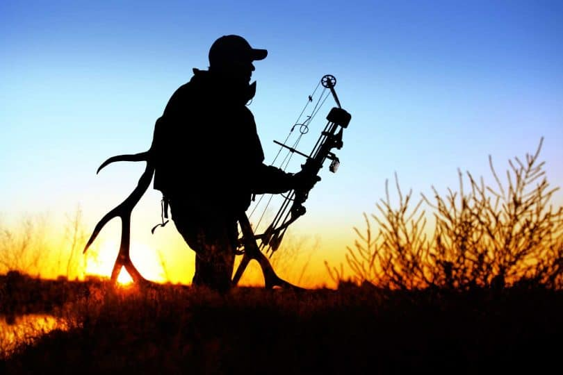 Hunter at sunset, silhouette