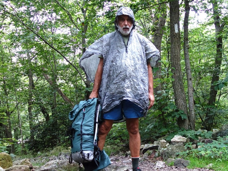 Man hiking and wearing a gore tex poncho