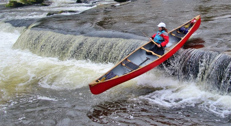 canoe jumping in the river