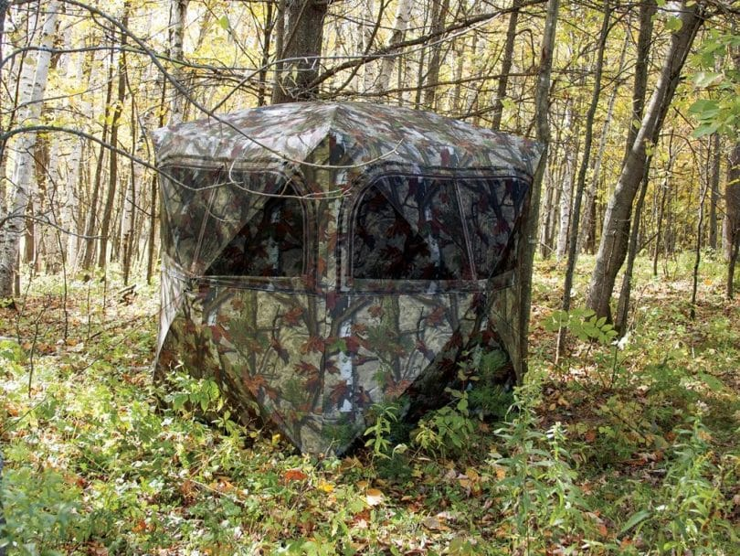 deer blind made from camouflage mesh in the forest