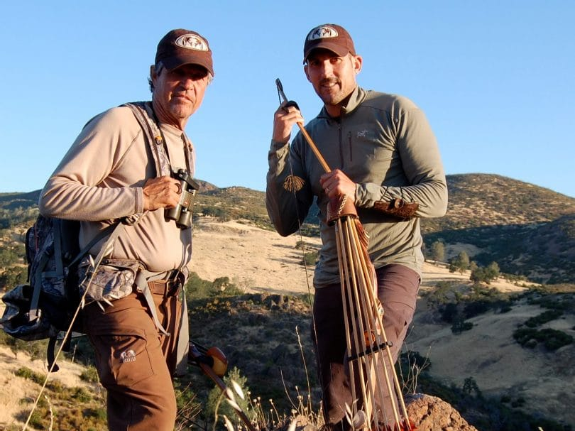 Two hunters wearing base layers looking into the camera
