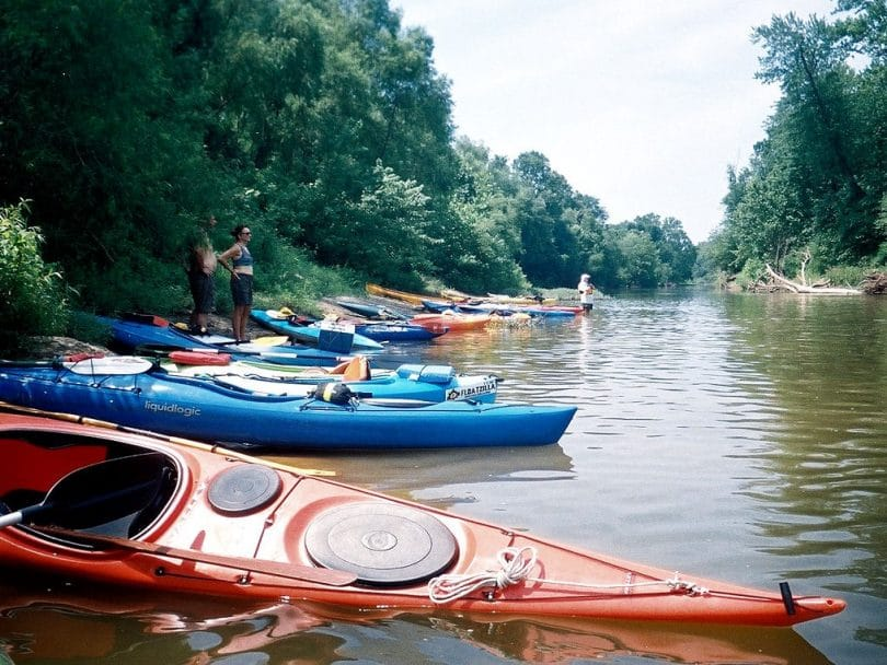 kayaks resting on a river bed