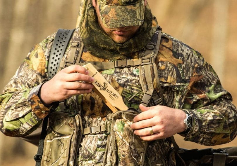 Hunter using the vest pocket