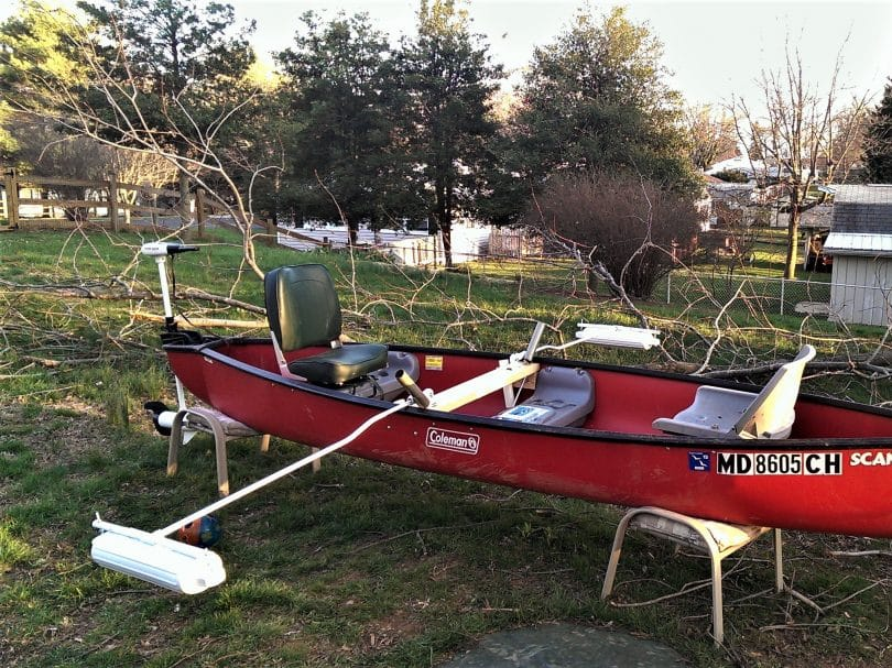 Red canoe with two pvc stabilizers