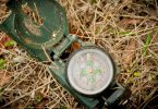 Dirty green compass on the ground