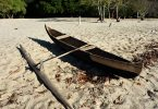 Wooden canoe on a beach