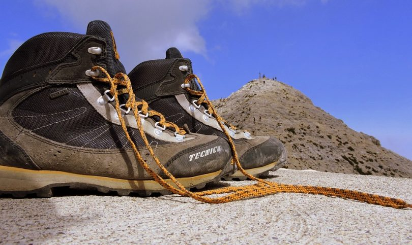 Hiking boots lying on top of the mountain