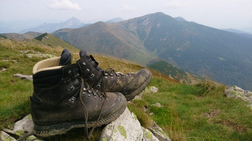 Hiking boots on a stone