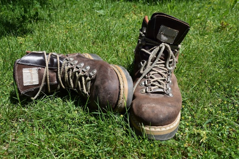 Hiking boots on green grass