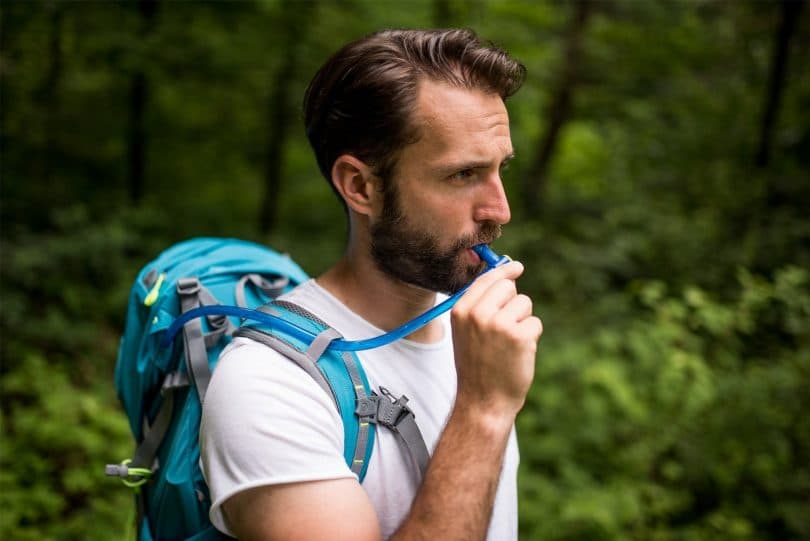 Man drinking water from CamelBak