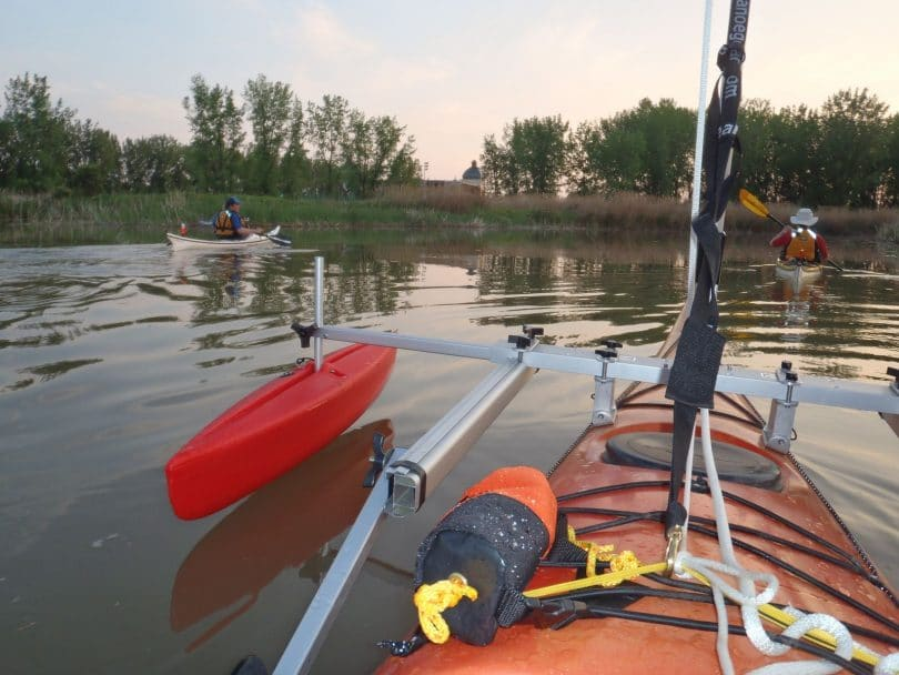 Two red stabilizers on a kayak