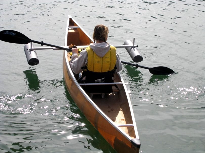 Woman in a Canoe with 2 stabilizers