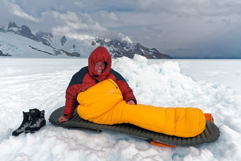 A man sits in a sleeping bag