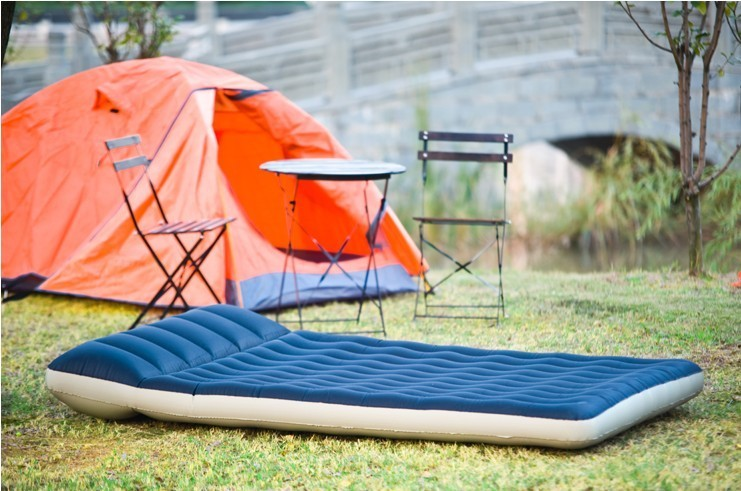 camping air mattress on grass
