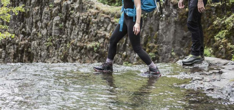 Hiking boots crossing the stream