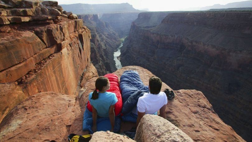 People sleeping on the edge of a cliff