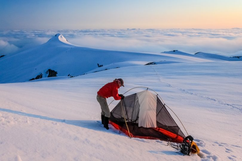 Setting up tent on the snow