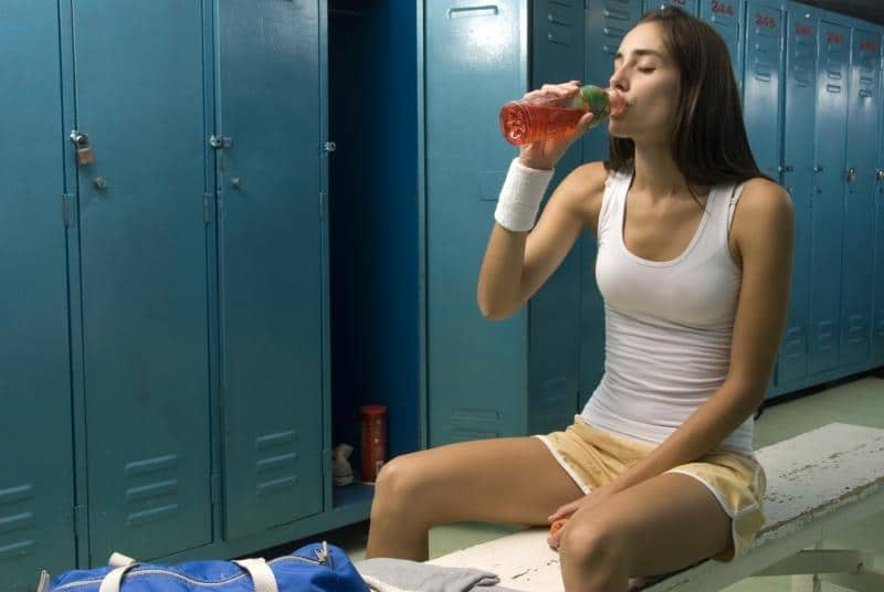 The athletic young woman with a protein drink