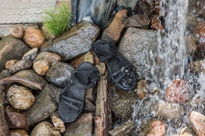 A pair of hiking sandals near water
