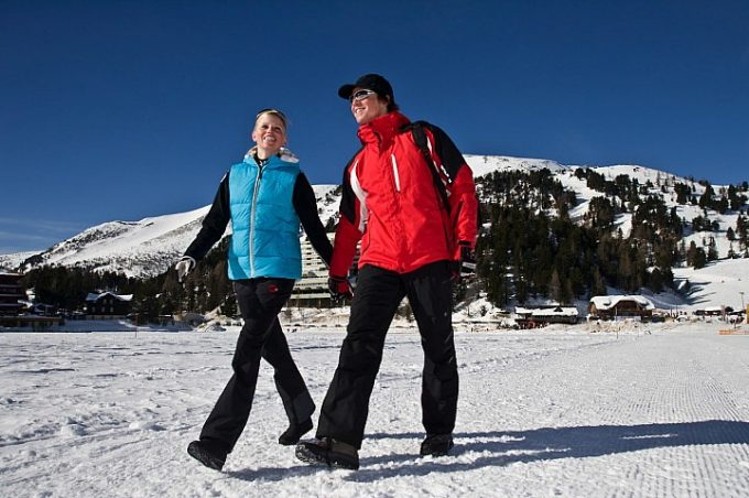 Couple hiking in snowy mountain