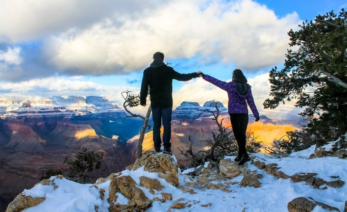 Couple holding hands Grand Canyon