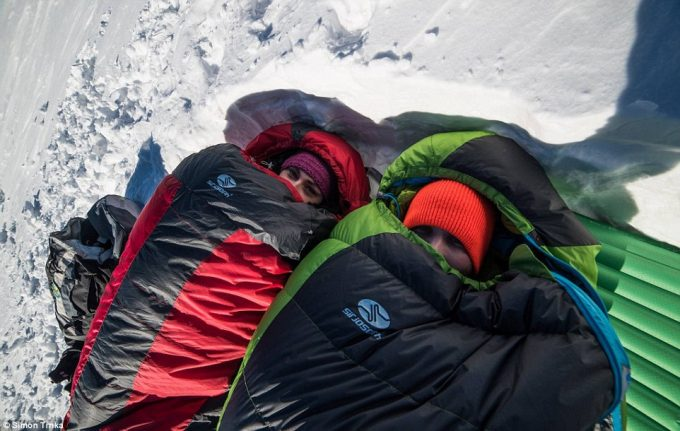 Couple in sleeping bags outdoors