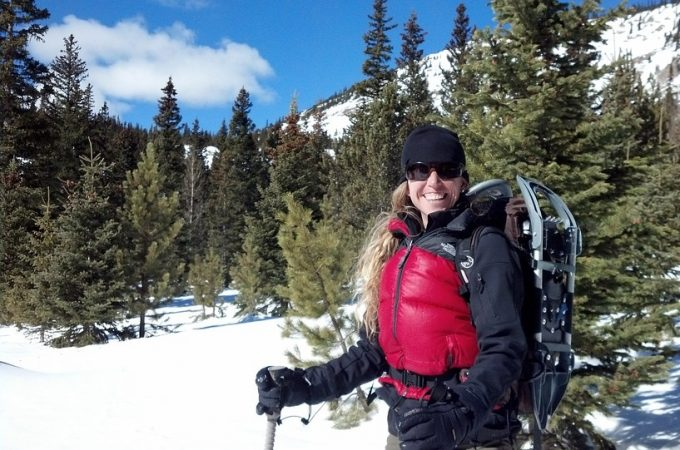Female hiker in ski sunglasses