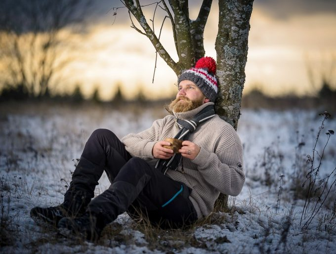 Hiker relax in the winter mountains