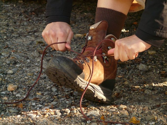 Hiker tying his boots in forest
