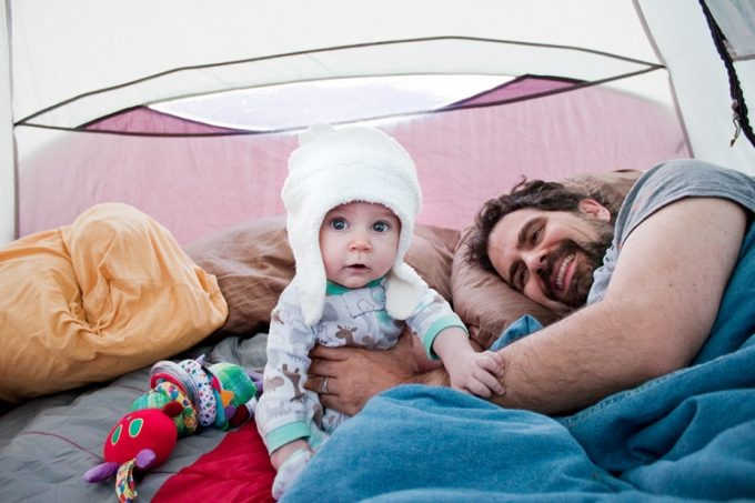 Little baby with father in camp tent